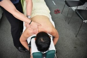 SGPS Sports Massage - Chiropractor massaging a man's back 2
